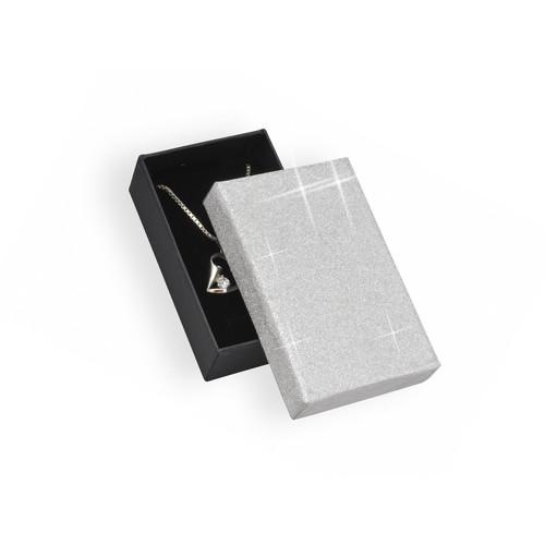 Černá krabička se třpytivým stříbrným víčkem a černým vnitřkem
